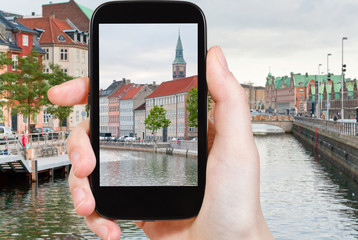 tourist taking photo of Copenhagen cityscape