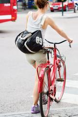 Fototapete - Woman and red bike.