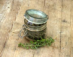 Dry Herbs in Glass Bottle
