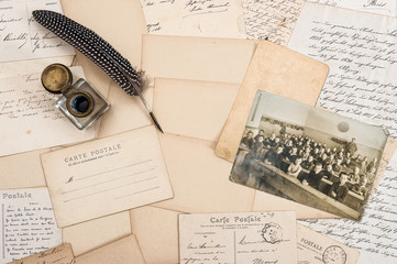 Old letters, antique feather pen and vintage photo of children