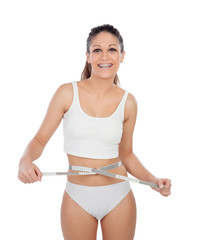 Attractive young woman in underwear with a tape measure