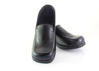 Black leather shoes on white background