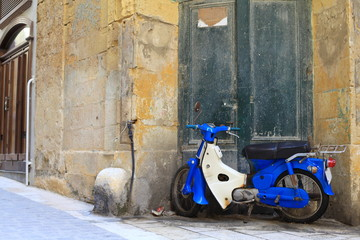 Classic Italian urban scene with scooter