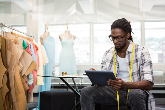 Fashion african american designer using digital tablet