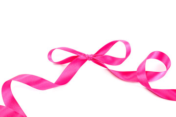 Festive pink ribbon curls on a white background.