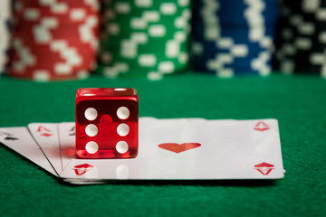 two aces with dice and chips
