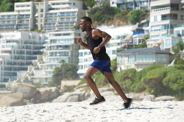Young man exercise running on the beach