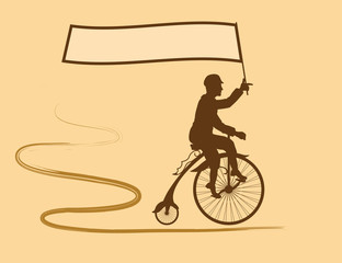 Young man riding a bicycle quickly in the hand holding the flag