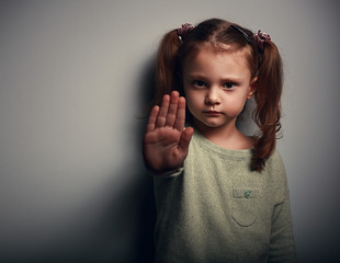 Angry kid girl showing hand signaling to stop useful violence