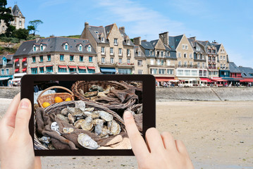 travel concept - tourist taking photo town Cancale