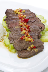 Sliced meal meat with red pepper garlic and cucumber