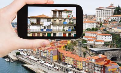 tourist taking photo of Porto city