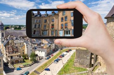 tourist taking photo of Sedan town, France