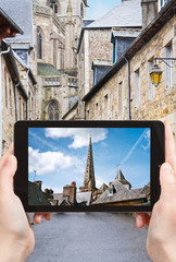 tourist taking photo of Cathedral in Treguier