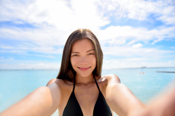 Selfie woman taking self portrait at beach holiday