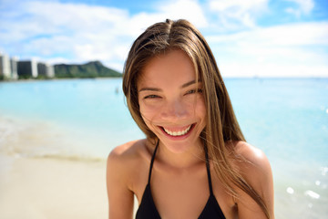 Happy healthy smiling Asian woman - beach vacation