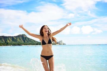 Wall Mural - Beach fun woman happy on Hawaii vacations holiday