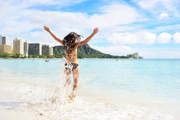 Wall Mural - Waikiki beach fun - happy woman on Hawaii vacation