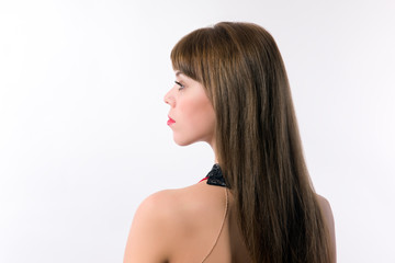 Young woman posing in profile