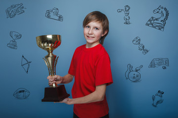 Teen boy Brown European appearance holds the cup prize, sport sy