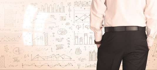 Businessman with diagrams and graphs