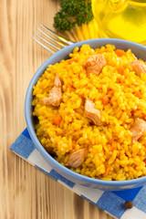 bowl full of rice on wood