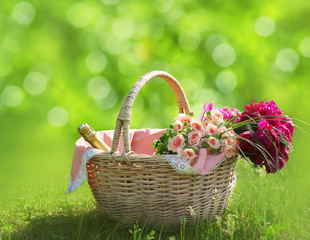 Romance, love and valentine's day concept - basket and flowers