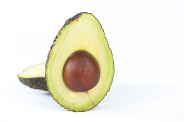Avocado fruit on white