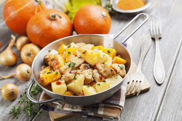 Chicken stew with pumpkin, potatoes and spices