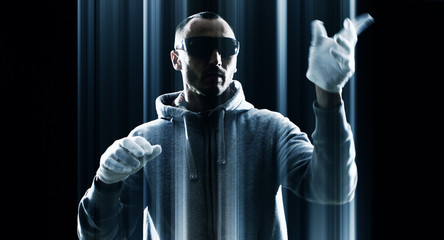 Hacker hacking, futuristic virtual keyboard, black background