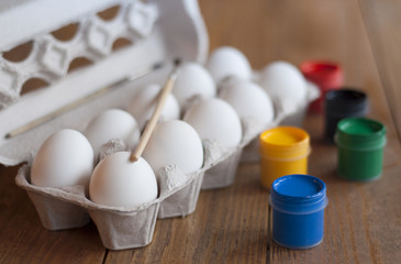 Eggs in box and paint. Preparation for Easter.