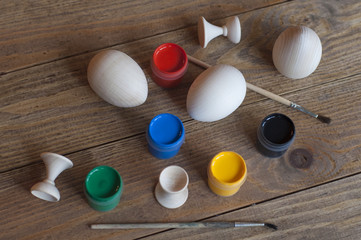 Wooden eggs and paints for making souvenirs for Easter.