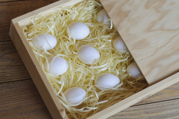 White eggs in a wooden box