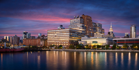 Fotomurales - West Chelsea buildings at sunset from Hudson River, New York Cit