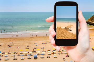 tourist taking photo of Atlantic beach