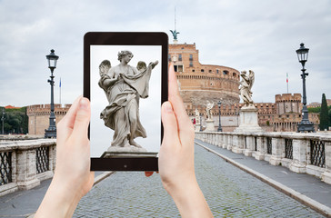 taking photo of statue on St Angel Bridge, Rome