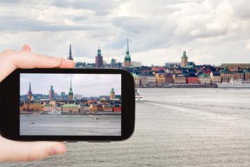 tourist taking photo panorama of Stockholm city