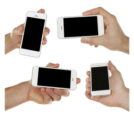Hands holding smartphones isolated on white