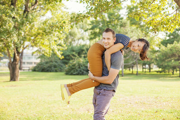 man lifting his girlfriend