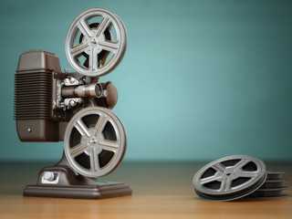Video, cinema concept. Vintage film movie projector and reels on