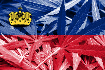 Lichtenstein Flag on cannabis background. Drug policy.