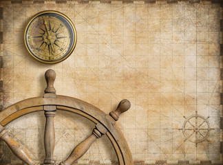 Foto auf AluDibond Schiff steering wheel and compass with vintage nautical map