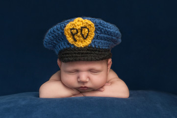 Newborn Baby Boy Wearing a Police Hat