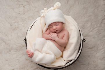 Sleeping Baby Girl in Bucket