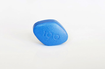 Blue pills for erectile dysfunction treatment - white background