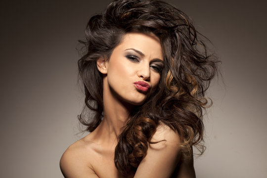 marvelous beautiful brunette posing in the studio - hair styling