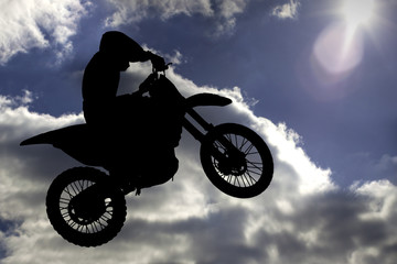 Motocross - silhouette with blue sky with sun