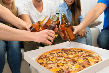 Friends Having Beers And Pizza