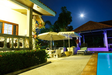 Villa with pool at night