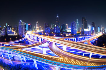 illuminated traffic on elevated expressway in modern city. Fotobehang